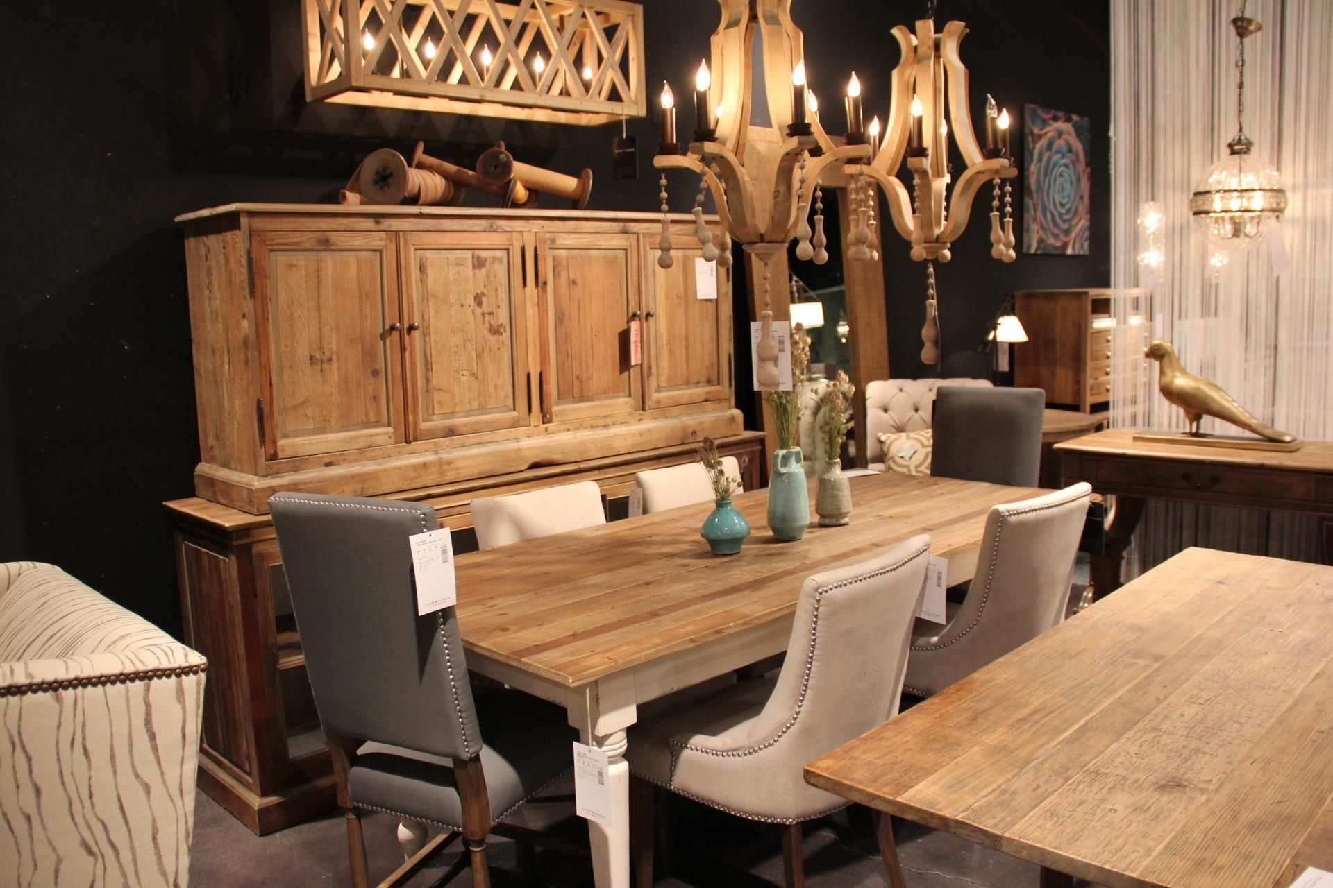 Unique wooden chandeliers and lighting plus matching buffets and