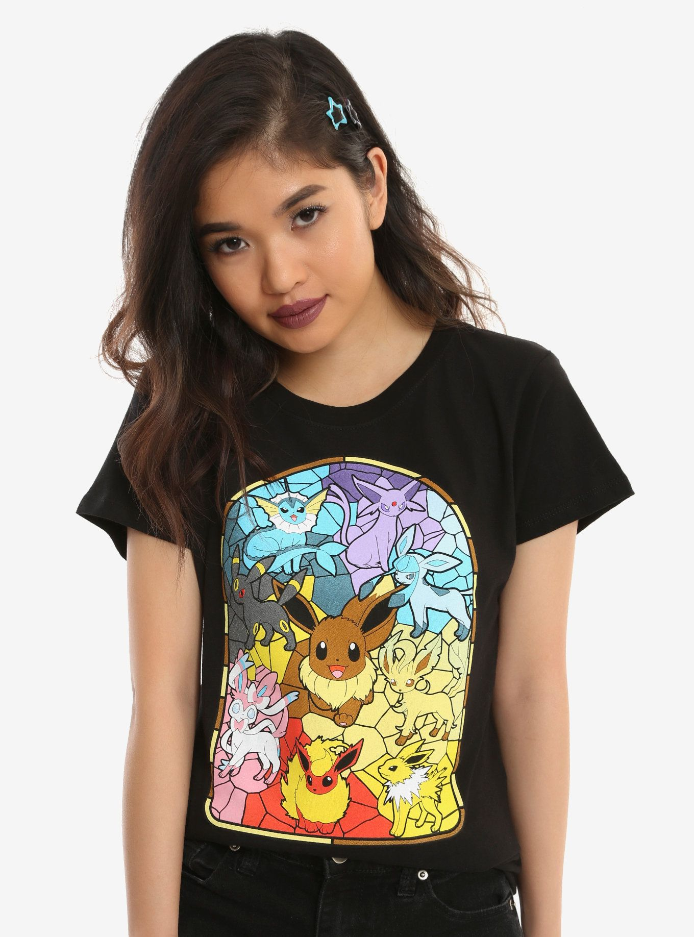 af15d471 Catch all the evolutions of Eevee with this fitted black tee from Pokemon .  The front screen features a stained glass style graphic with a colorful ...