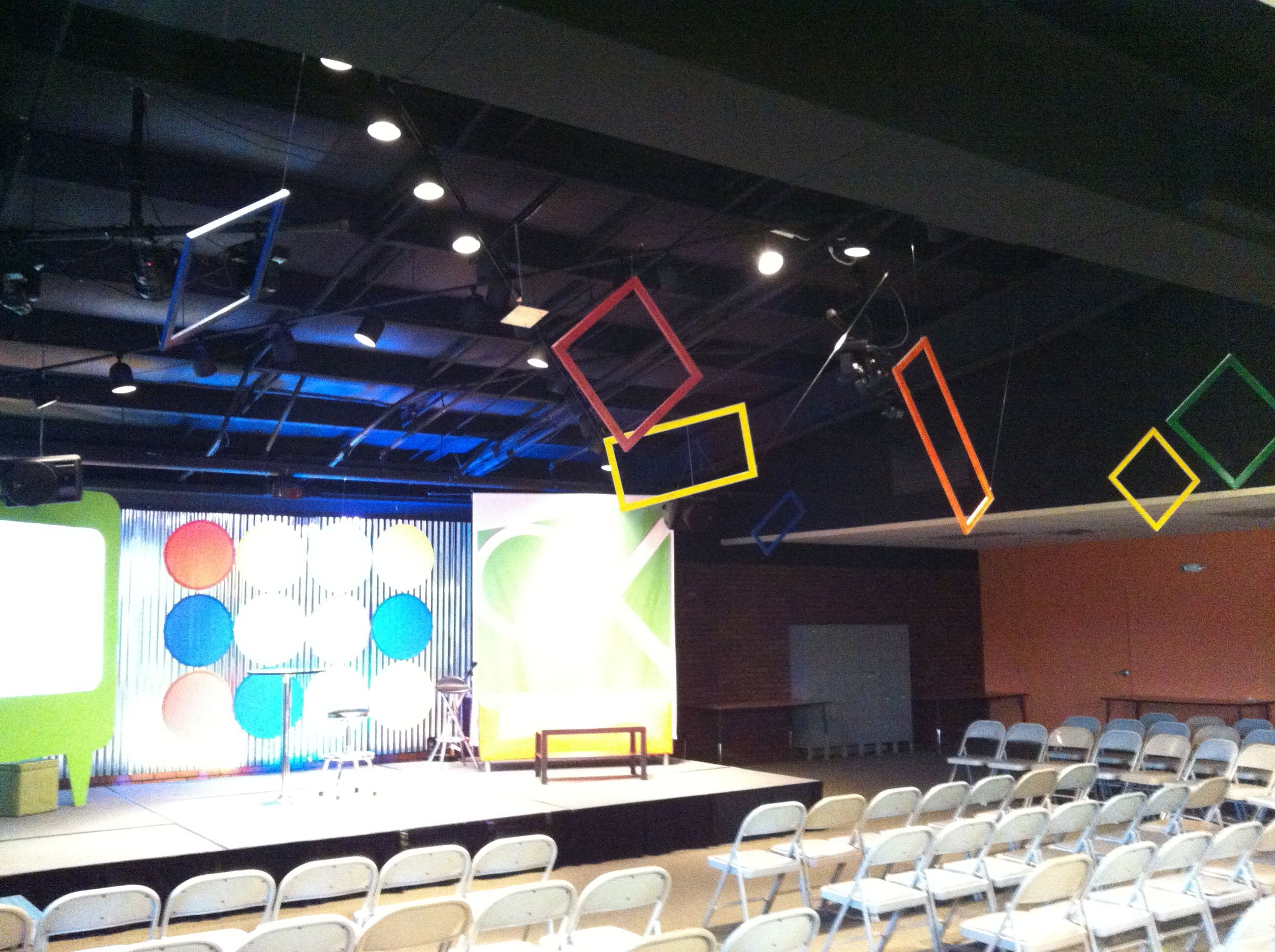 Love the frames suspended from the ceiling for Meeting or