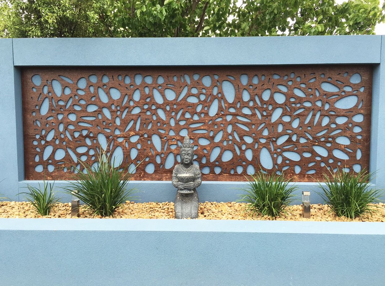 Decorative wood screen used to decorate a concrete fence for Decorative wall fence