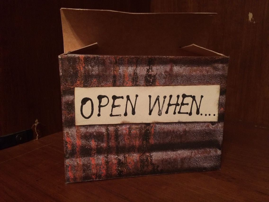 "Decorated box for ""Open When...."" Letters using an empty envelope box, scrapbook paper, and ink."