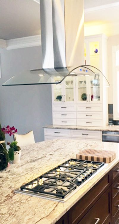 This Curved Glass Stainless Steel Range Hood Looks