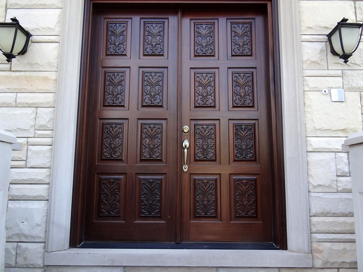 Carved double doors design ideas with wooden materials and for Exterior wooden door designs