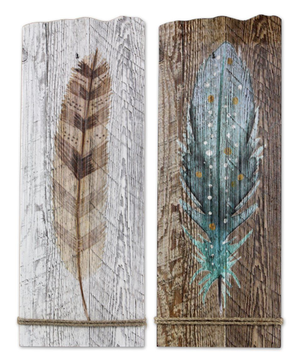 Take a look at this wood feather wall art set of two today art