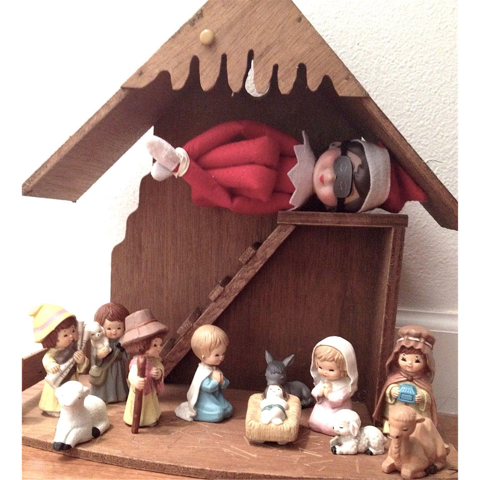 Elf sleeps by the Nativity
