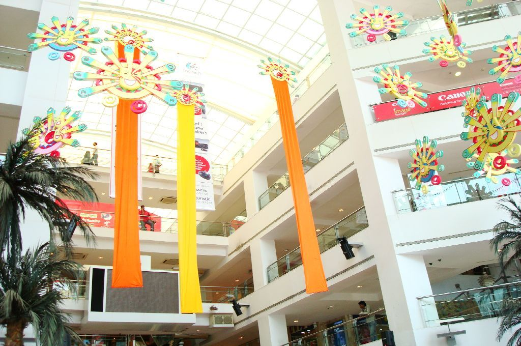 Atrium decor masquerade theme atria mall anniversary for Atrium design and decoration