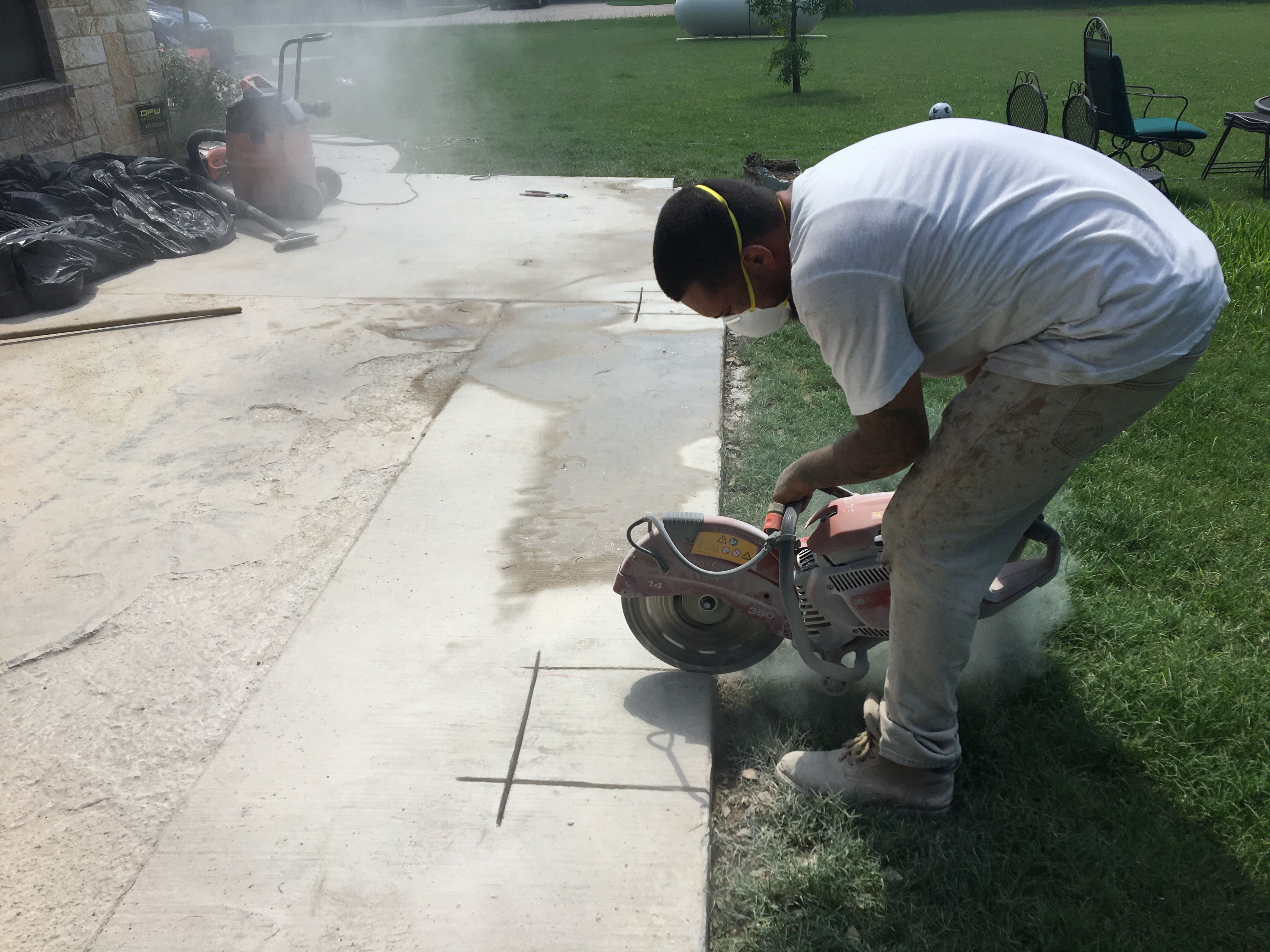 Cutting To Out Piers In This Concrete Patio Here In Wylie