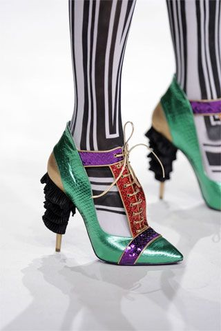 Viktor & Rolf Spring 2009 shoes. Combine the bright color with simple jeans or be egdy enough for this combi with black and white graphs.