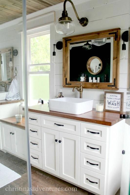 Photo of vintage inspired farmhouse bathroom from glass shower butcher block countertops …