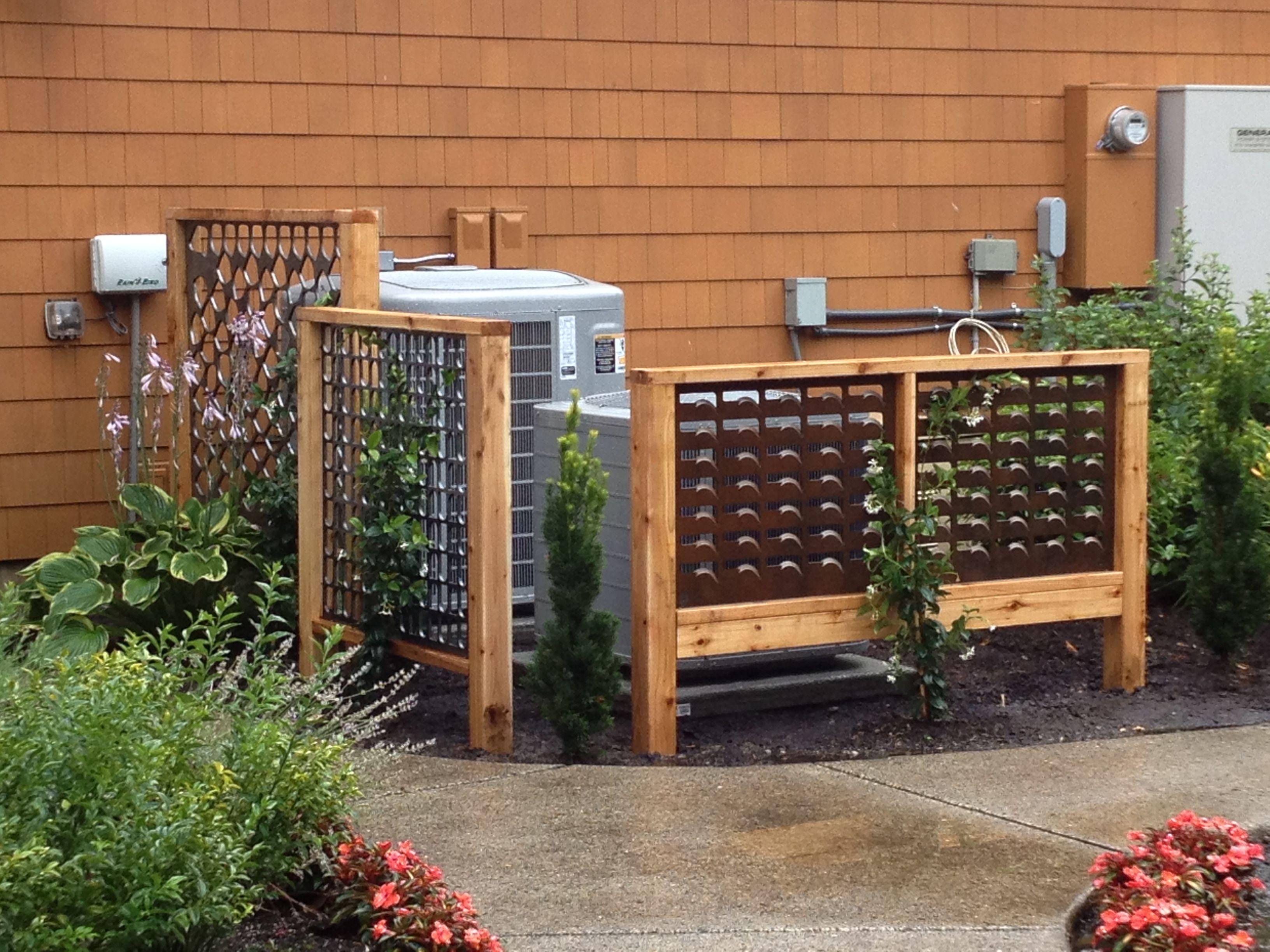 Custom iron panels hide AC units Laurel Hedge Design