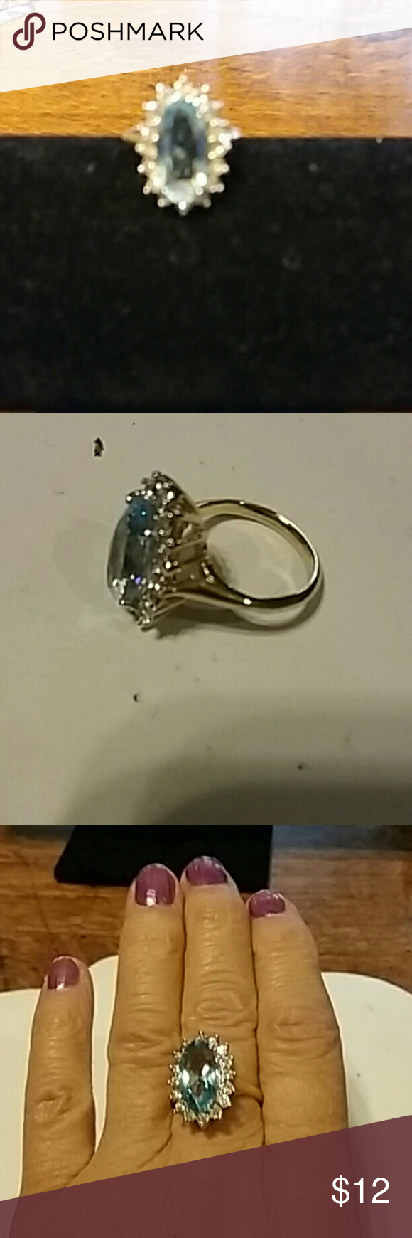 Vintage ring, costume Beautiful vintage costume ring with blue stone and clear stones around it. Gold tone size 6 and 3/4 Jewelry Rings