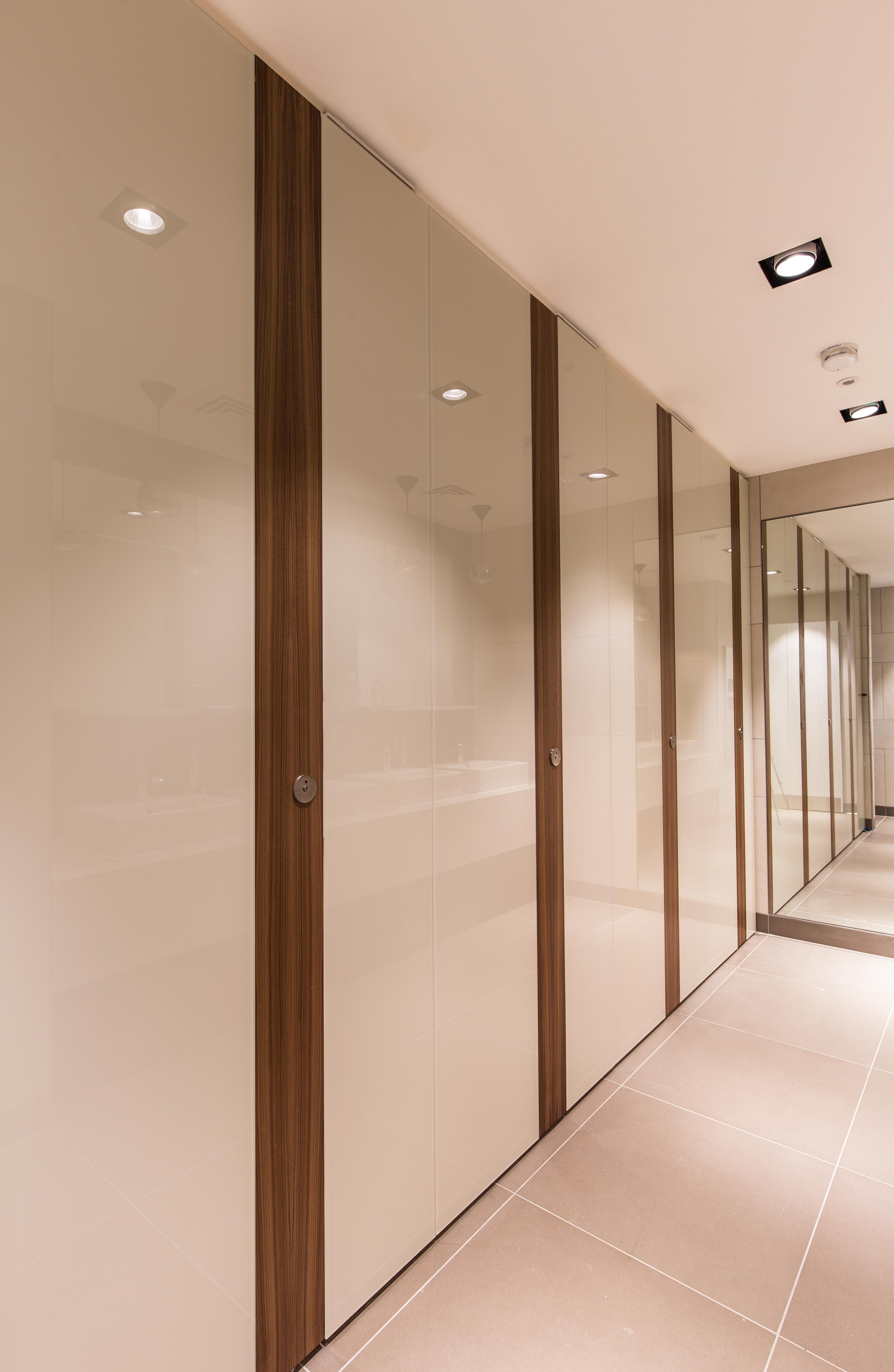 Alto Kristalla glass faced cubicle doors with contrast wood veneer faced pilasters. & Alto Kristalla glass faced cubicle doors with contrast wood veneer ...
