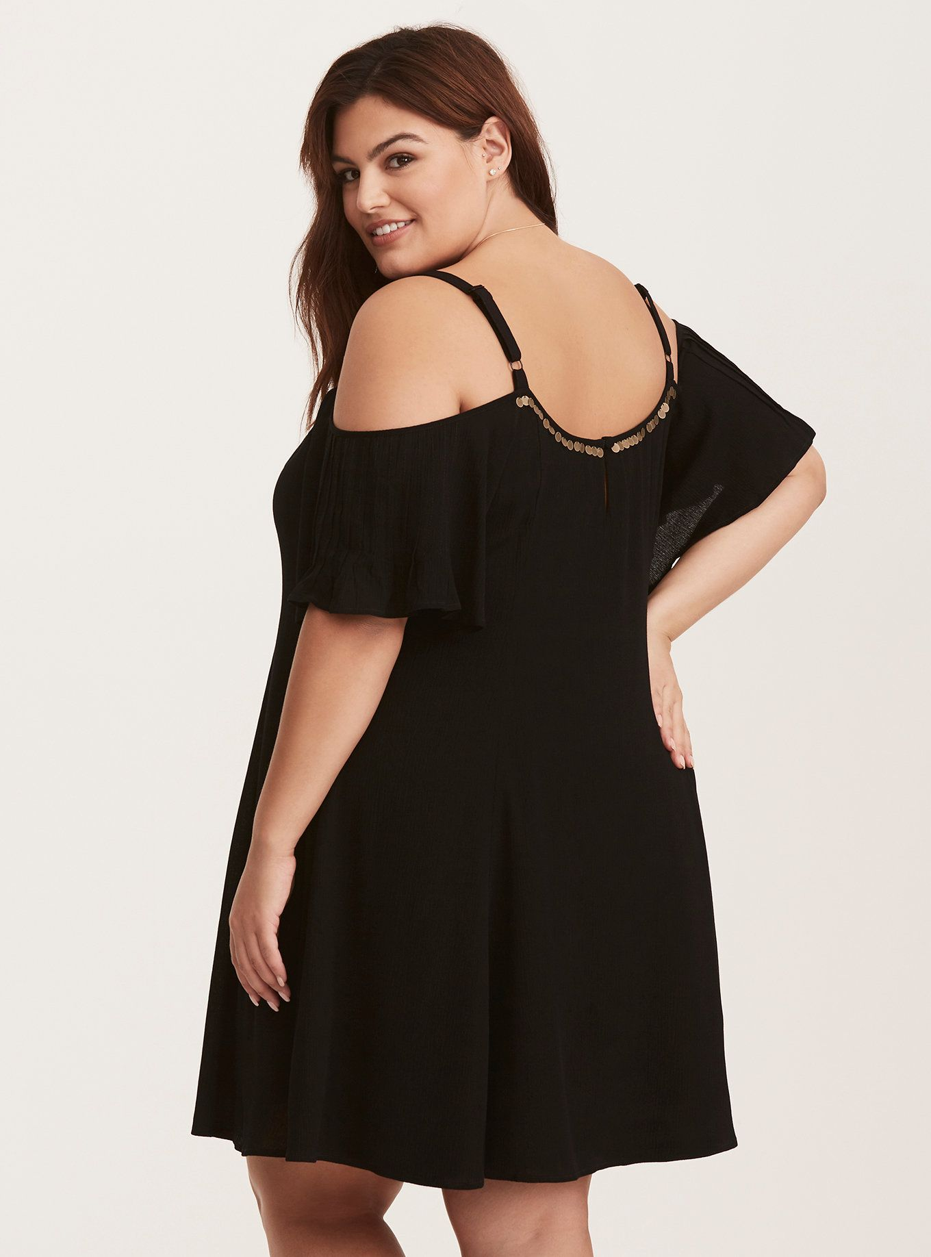 """Necklaces are no longer needed with this dress. Gold tone coins trim the neckline, adding shake-shake-shake quality. Pleats line the front lending flow.<div><ul><li style=""""list-style-position: inside !important; list-style-type: disc !important"""">Gauze fabric</li><li style=""""list-style-position: inside !important; list-style-type: disc !important"""">Scoop neck</li><li style=""""list-style-position: ins..."""