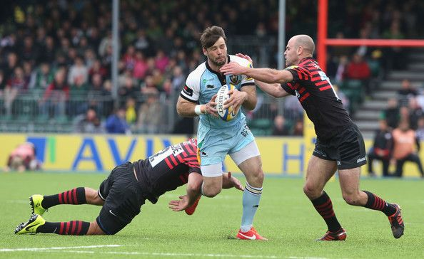 Ben Foden of Northampton is tackled by Schalk Brits (L) and Charlie Hodgson during the Aviva Premiership semi final match between Saracens and Northampton Saints at Allianz Park on May 12, 2013 in Barnet, England.