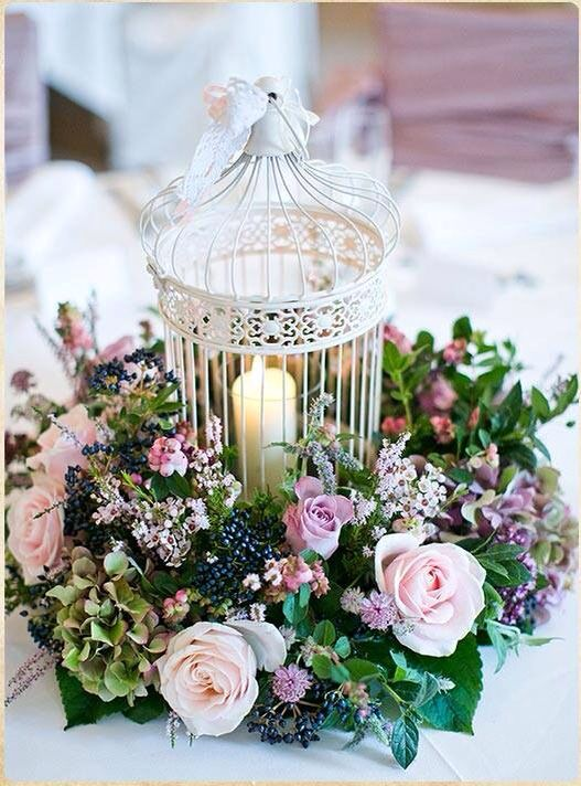 Candle In Birdcage With Floral Wreath Garland Around It