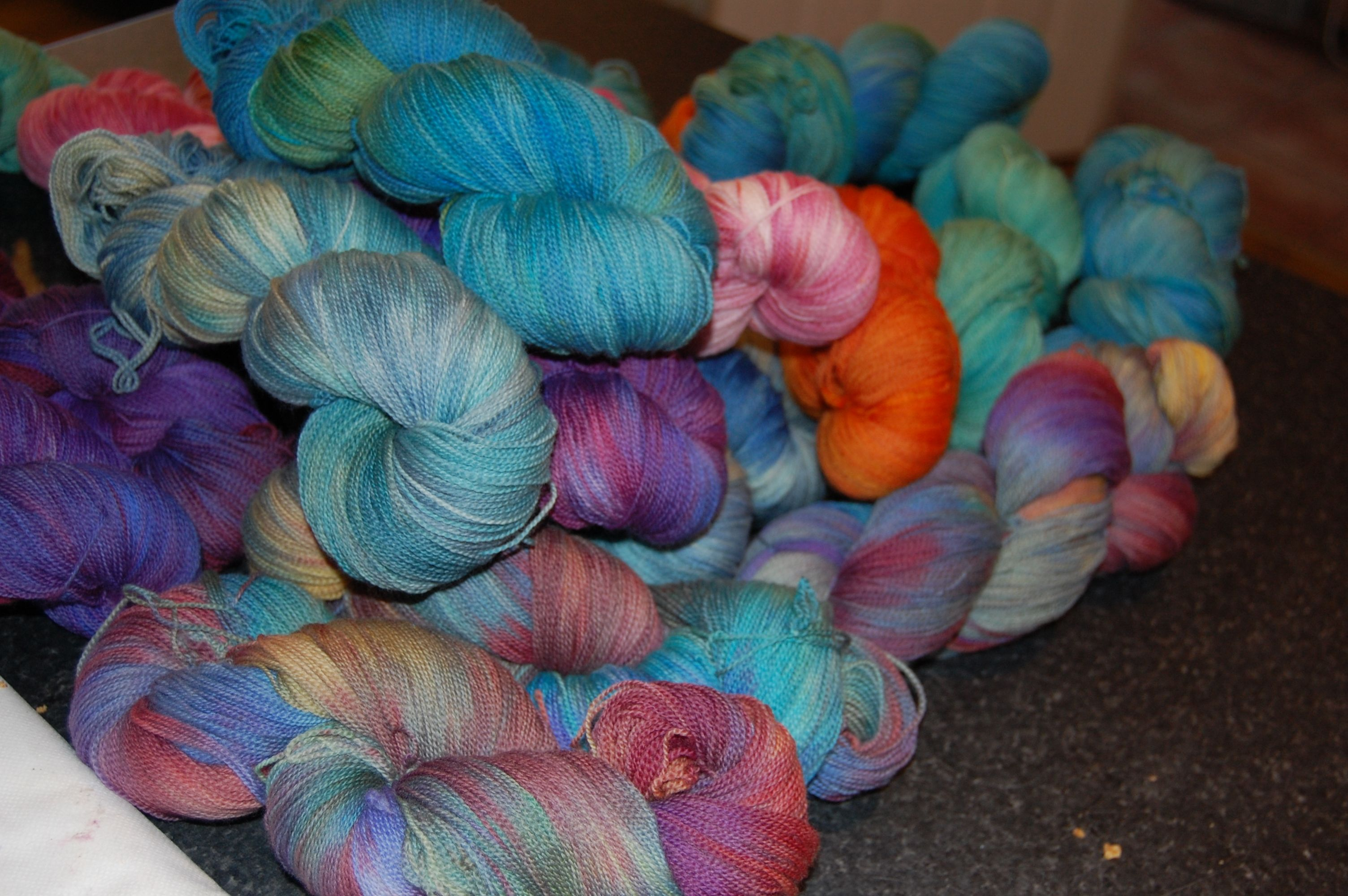 A pile of hand dyed lace yarn from Smudge Yarns in Ireland.