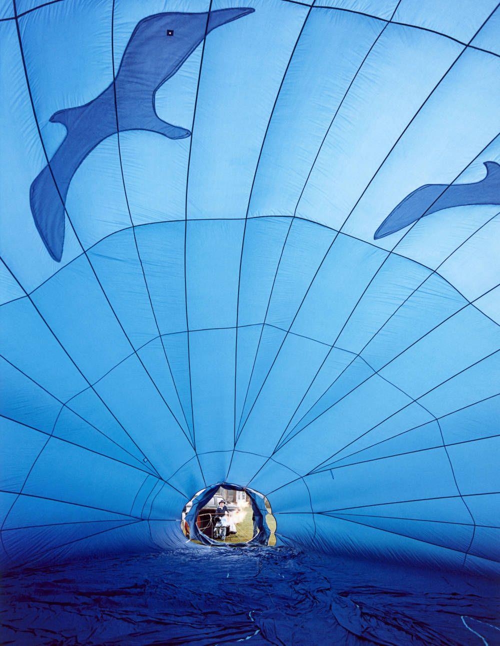 Inside a blue hot-air balloon