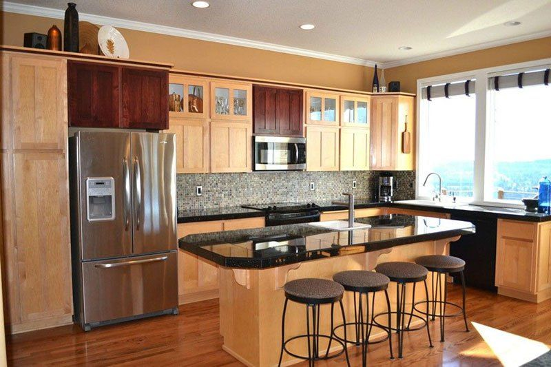 Black pearl granite with natural maple cabinets