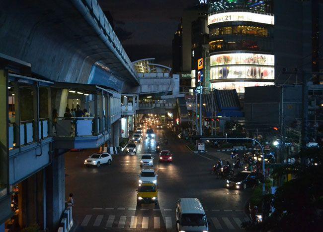 Night time at Asoke Interchange Junction in Bangkok. Terminal 21 and Sukhumvit Road beside Asok BTS Skytrain Station. For more on Bangkok city life check our blog: http://live-less-ordinary.com