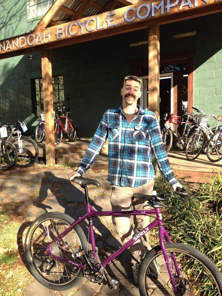 Kevin Sherman stands proudly beside his new Surly Bike. Diggin' the new bike!