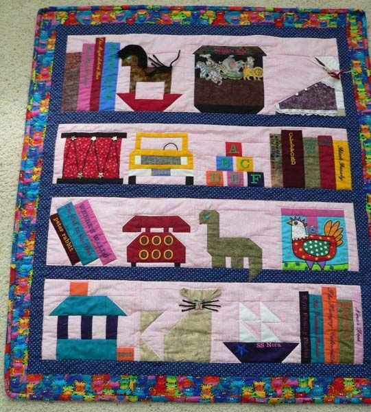 Baby Bookshelf Quilt This Is Made Of Different Blocks Toys That Are