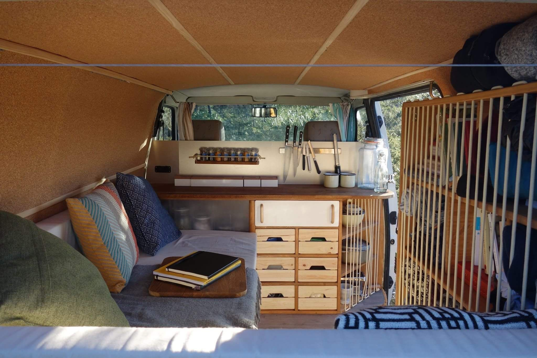 Instagram: @radius_ulna - Blog: www.radius-ulna.com - Cosy Camper van's interior design to travel thought Europe. Cork/wood/L shape Bed/ elastic rope/spice rack/organisation