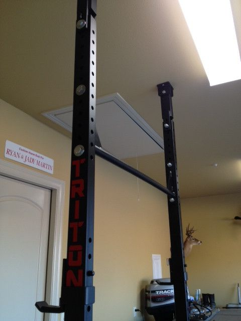 Triton phantom ceiling mounted collapsible squat rack