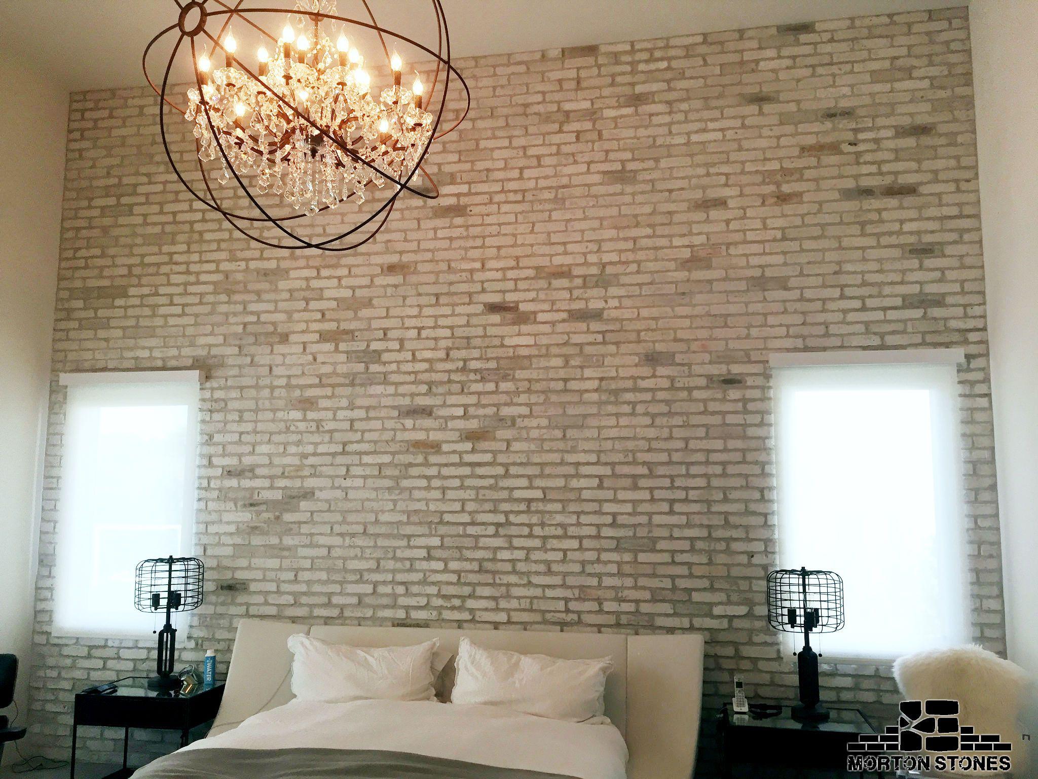 The White Brick Wall Transforms The Bedroom Into A Cozy Retreat Mortonstones Brick Tiles Rustic Home D White Brick Walls Fireplace Remodel Brick Veneer