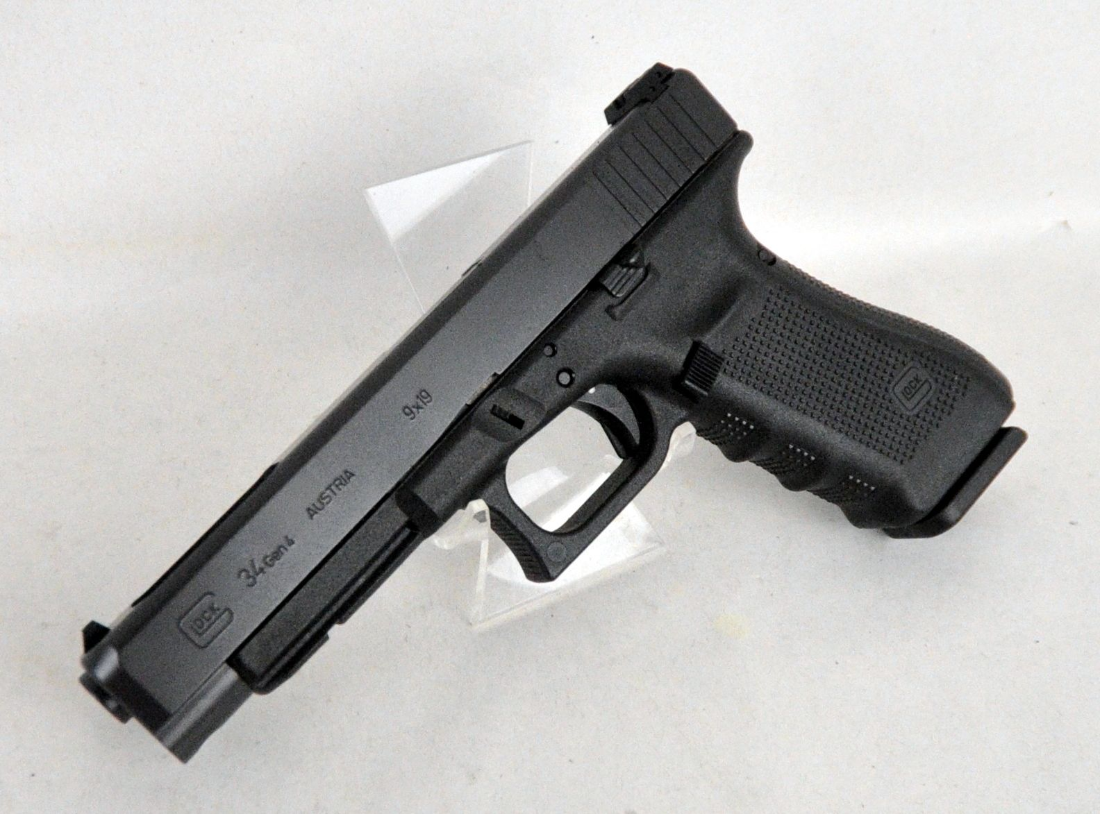 "Glock 34 Gen 4 9mm 5.31"" *NIB*. The 4th Gen Glock 34 is designed to be the same overall length as the Government Model 1911 pistols and thus introduces revolutionary design changes to the ""Tactical/ Practical"" Glock pistol. It features a Modular Back Strap design; a scientifically designed, real-world-tested, Gen4 rough textured frame; and an accessory rail for attachments. 17+1 capacity of .40 S&W. 5.31"" barrel. 25.95 oz. $624.99"