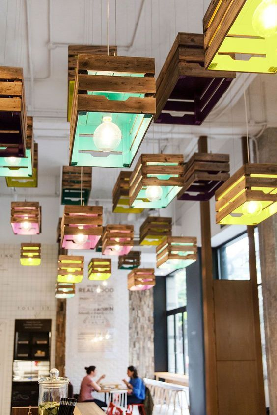 Lighting design idea wood crates painted on the inside act as shades in this restaurant also rh ar pinterest