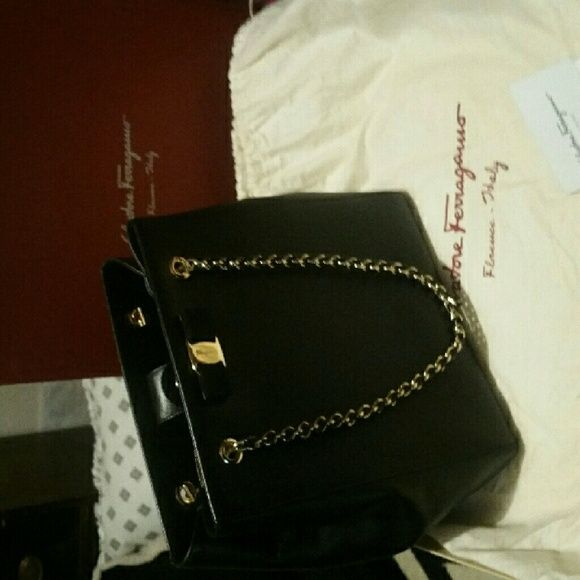 Salvatore Ferragamo authenticated. Beautiful gold chain and elegant  classical bow. For an evening wear. Comes with dust bag and original box.  Price is firm. c9e7246373