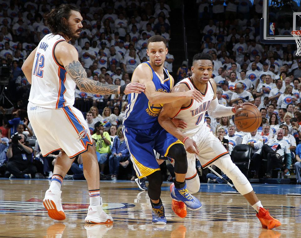 Oklahoma City\'s Russell Westbrook (0) goes past Golden State\'s Stephen Curry (30) and Steven Adams (12) during Game 4 of the Western Conference finals in the NBA playoffs between the Oklahoma City Thunder and the Golden State Warriors at Chesapeake Energy Arena in Oklahoma City, Tuesday, May 24, 2016. Oklahoma City won 133-105. Photo by Bryan Terry, The Oklahoman