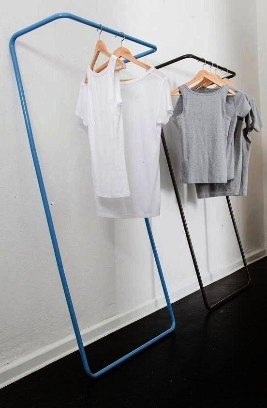 minimalist rail for hanging clothes in spacecompromised homes Source by trinejohnson clothes ideasA simple and minimalist rail for hanging clothes in spacecompromised hom...
