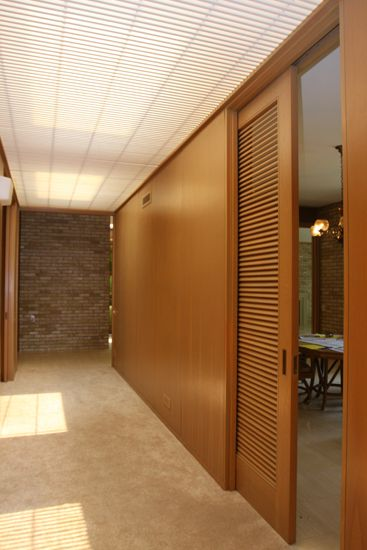 Louvered Door Used As A Pocket Room Divider