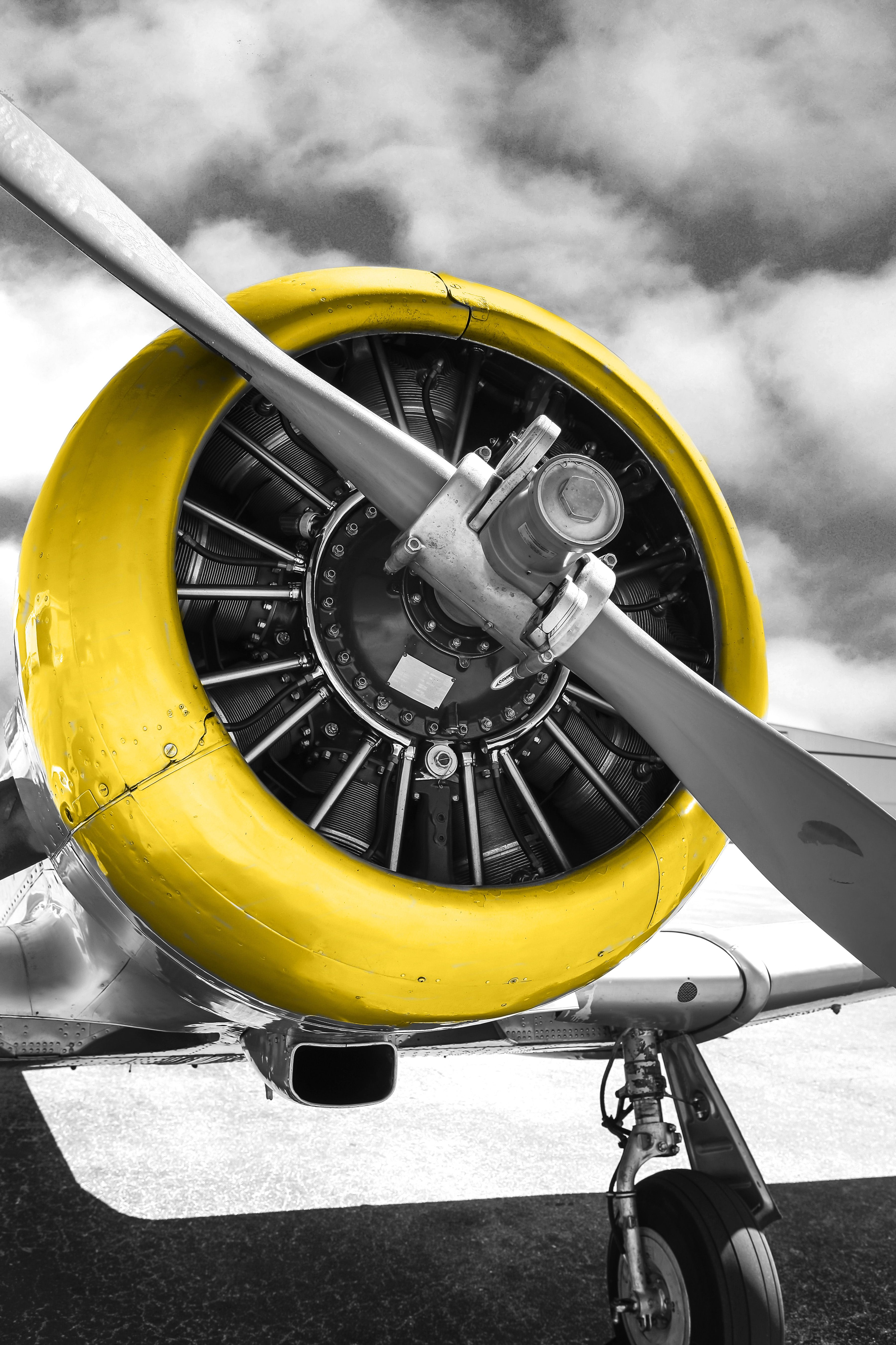 Radial engine and yellow cowling of an AT6 Texan vintage av ...