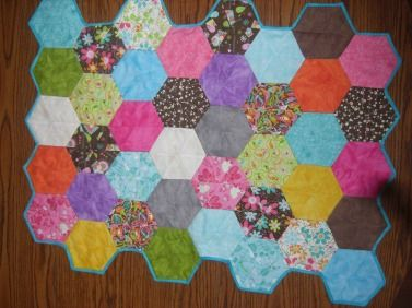 Hexagon quilt, make a good baby quilt, car seat quilt, lap quilt or table topper.  $30, visit my facebook page, http://www.facebook.com/HandmadebyJB for details on how to order.
