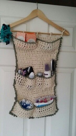 Extra bathroom storage i made out of cotton yarn and an old clothes hanger