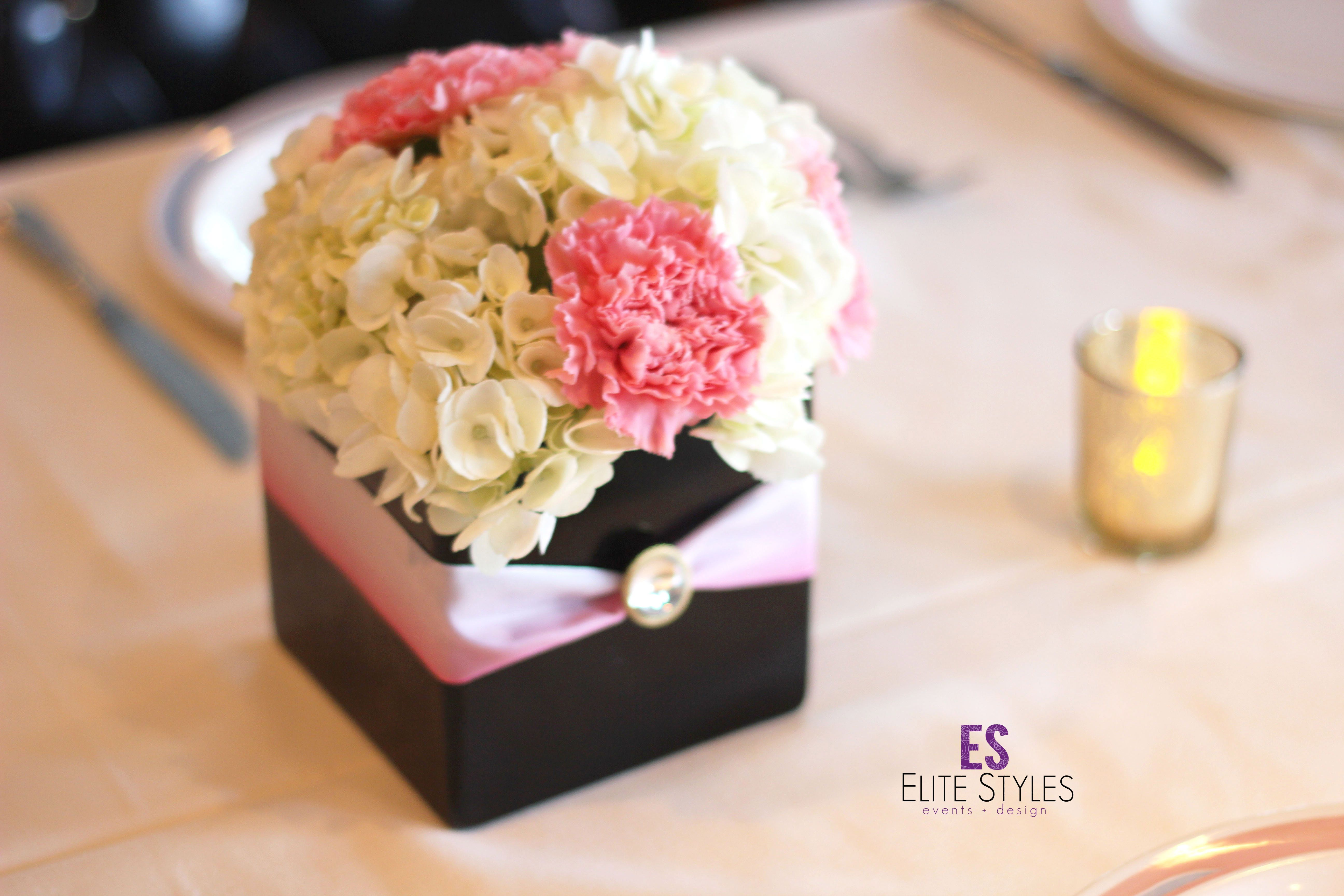 Decoration ideas for 40th wedding anniversary  Small flower centerpiece with pink ribbon around the box base