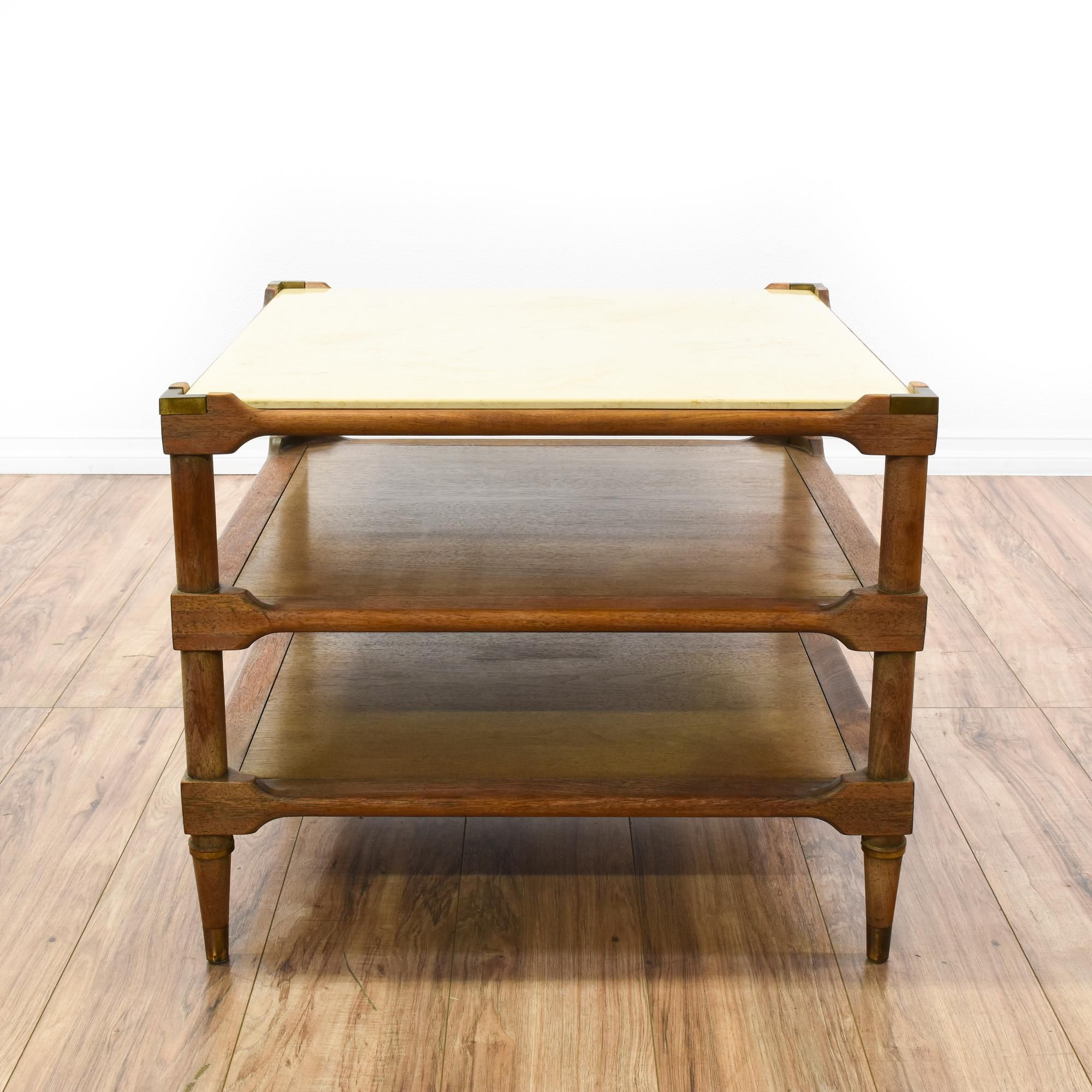 This end table is featured in a solid wood with an oak finish this