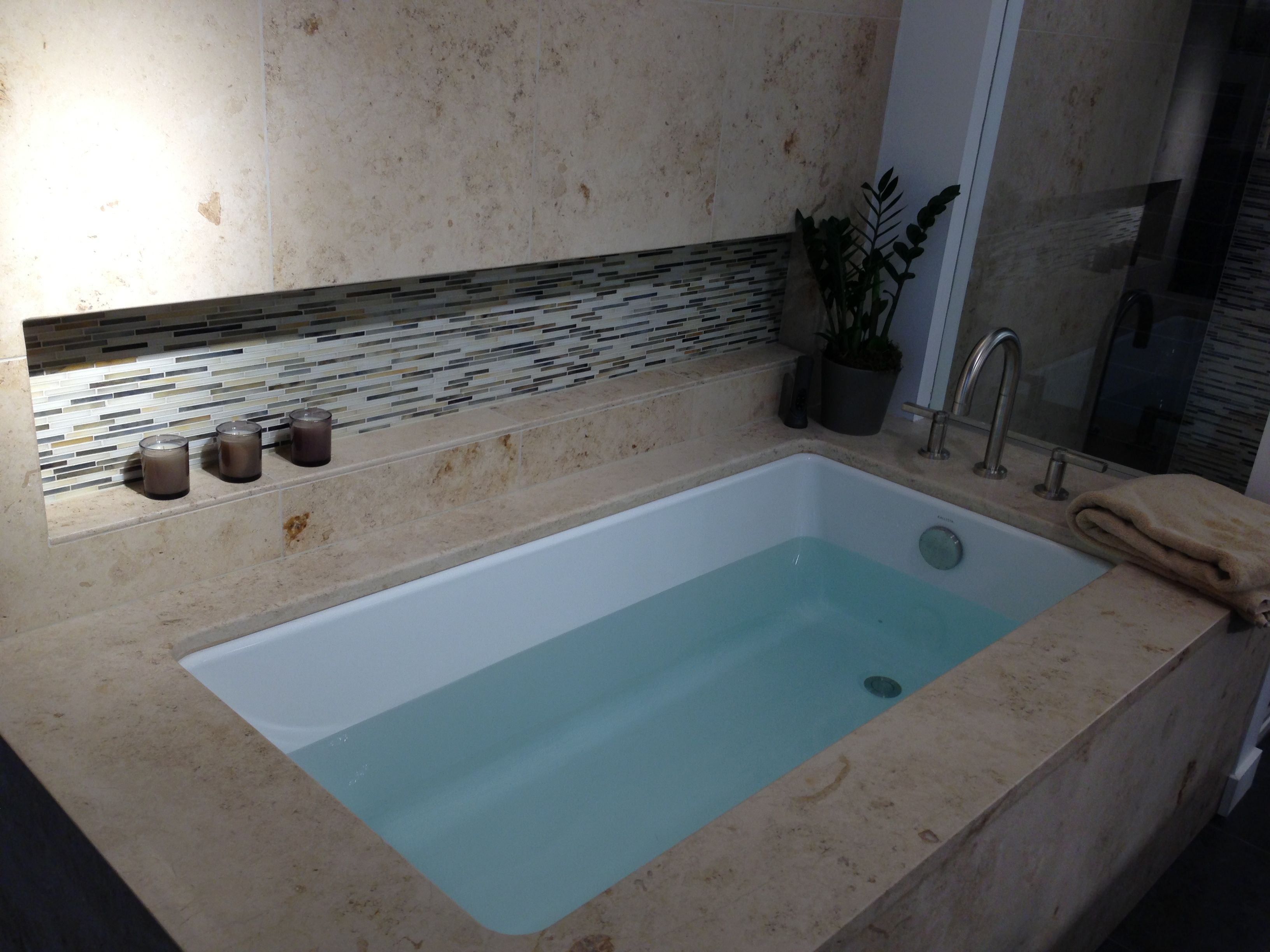 Undermount soaking tub with alcove shelf in contrasting tile ...