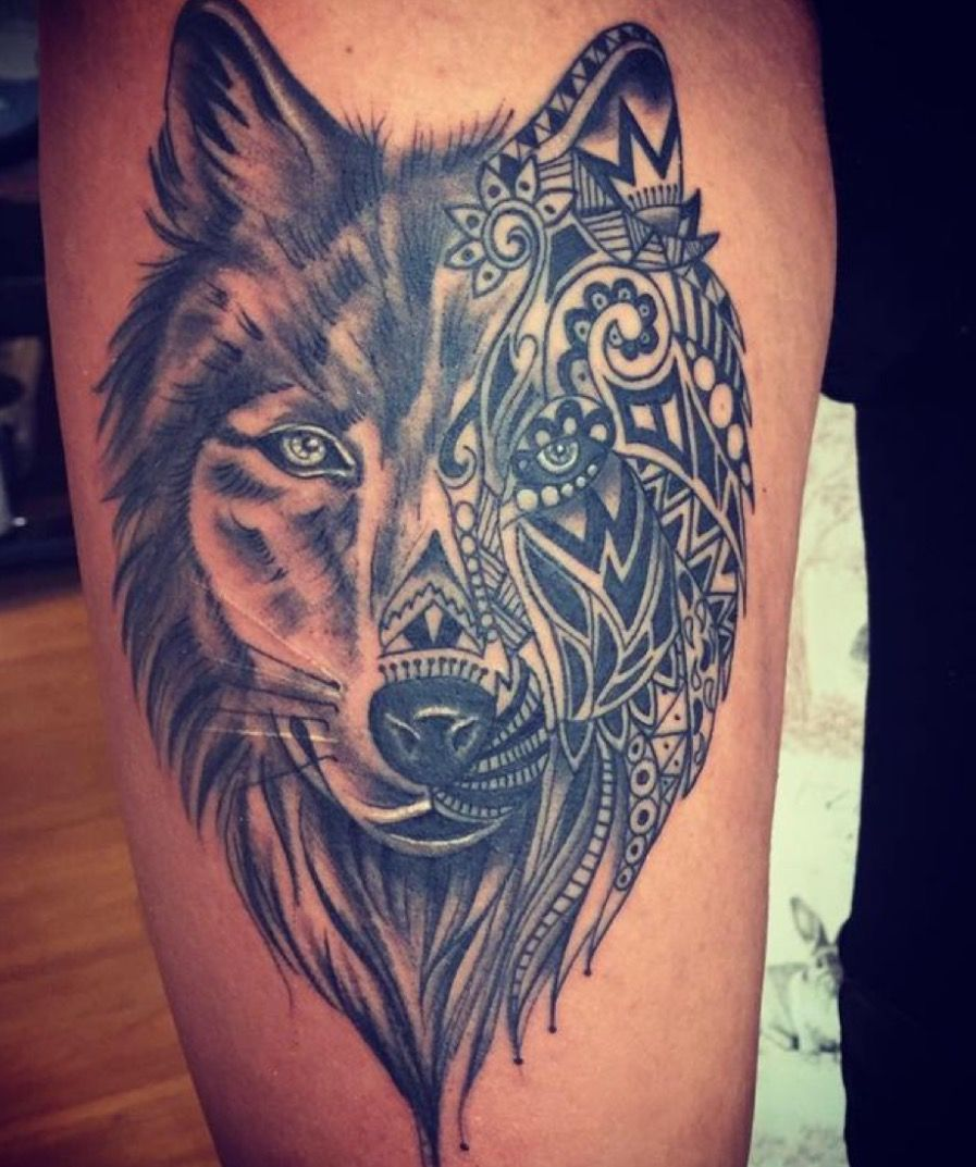 Front Facing Wolf Thigh Tattoo With A Tribal Design For Half The Face Obsessed Wolf Tattoos For Women Wolf Tattoos Wolf Tattoo Design