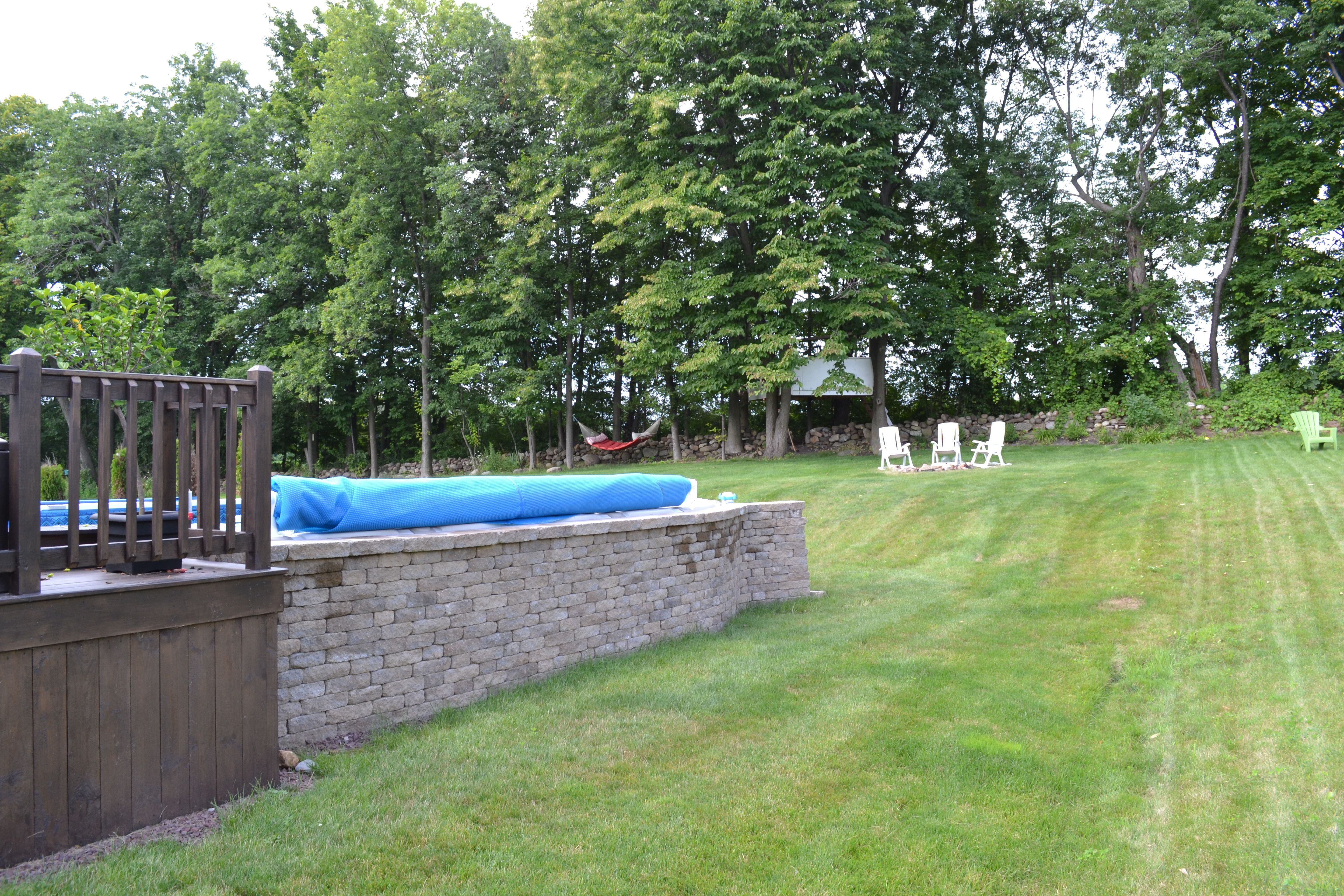 Our Oval Above Ground Pool With A Stone Wall My Husband Built Around It