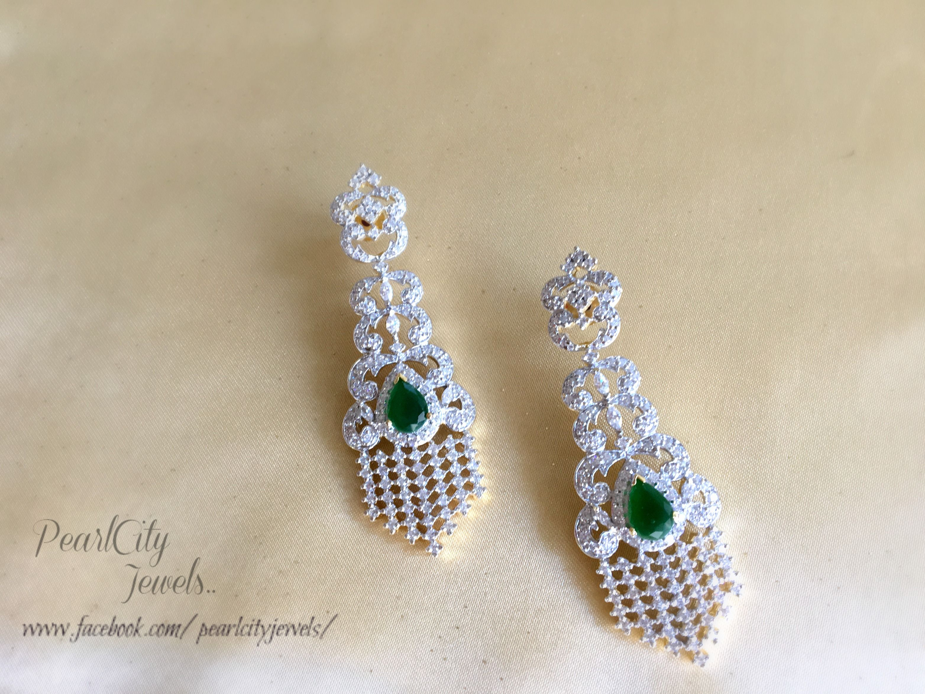 American Diamonds with Green Emerald stone. Perfect for any occasion...