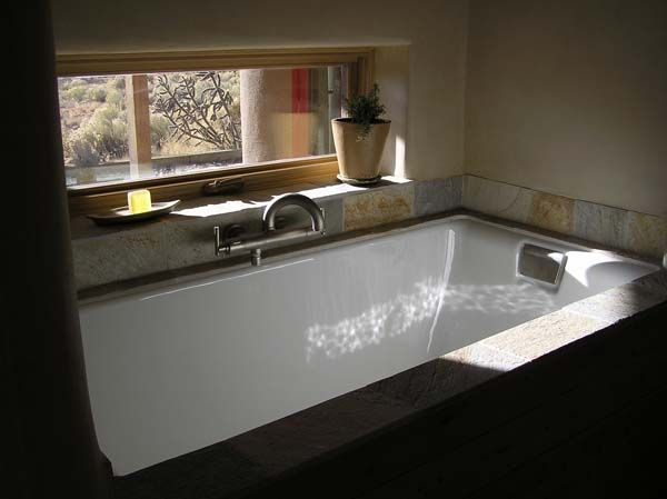 kohler tea for two soaking tub with gorgeous views out to the mountains - Kohler Bathtubs
