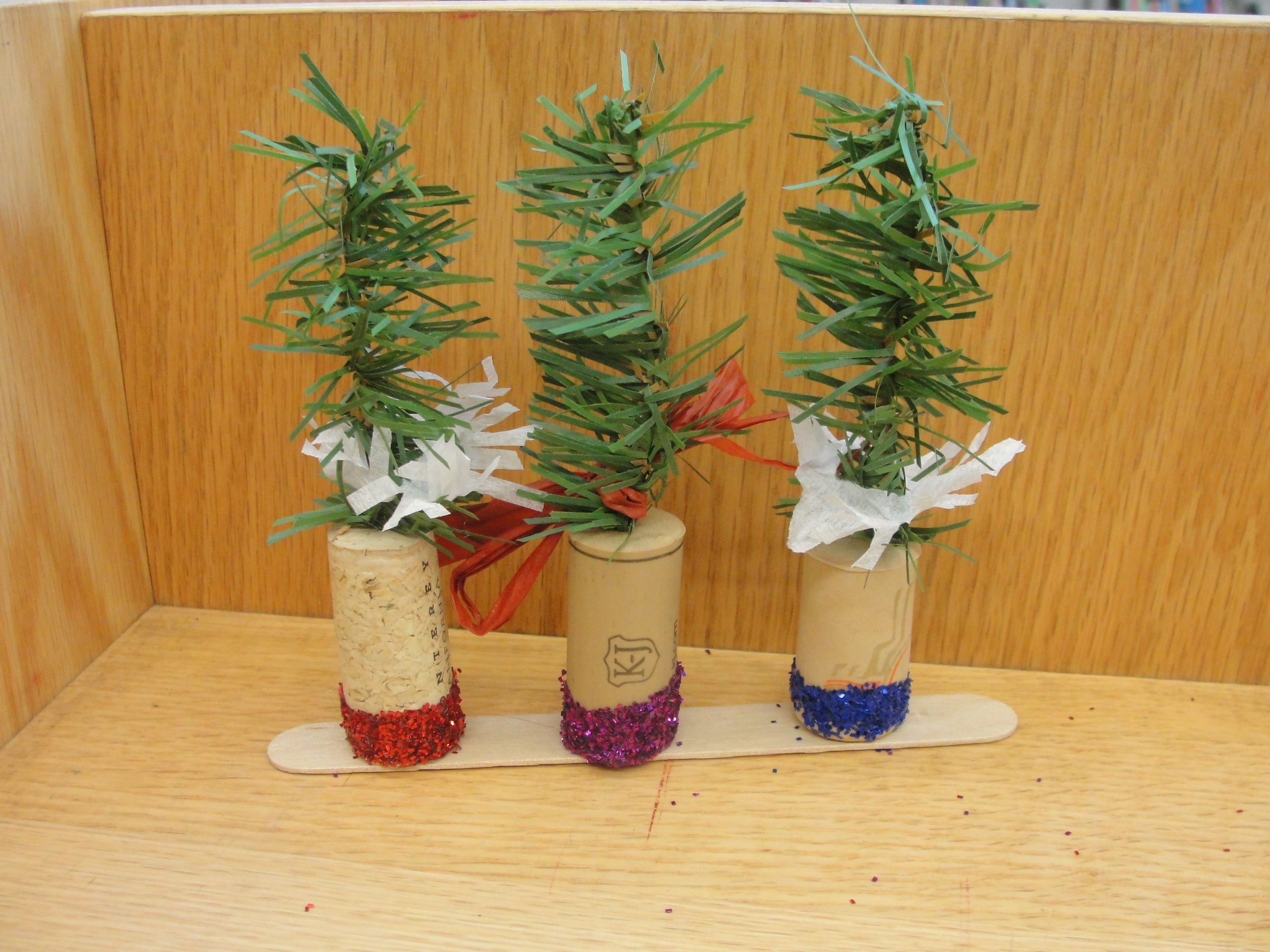 Mini cork trees - glitter on bottom, 3 mounted on a popsickle stick for easy transport