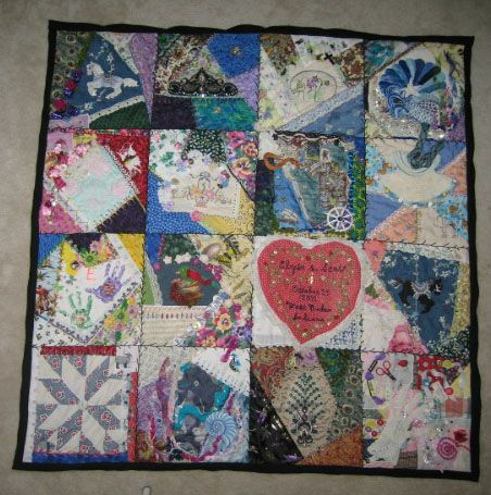 Elyse and Scotts Wedding quilt made with things given to me by friends and family