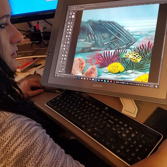 Amanda Turner creating the West Suffolk Hospital's Day Surgery & Eye Clinic window art. Pintsizeart.com