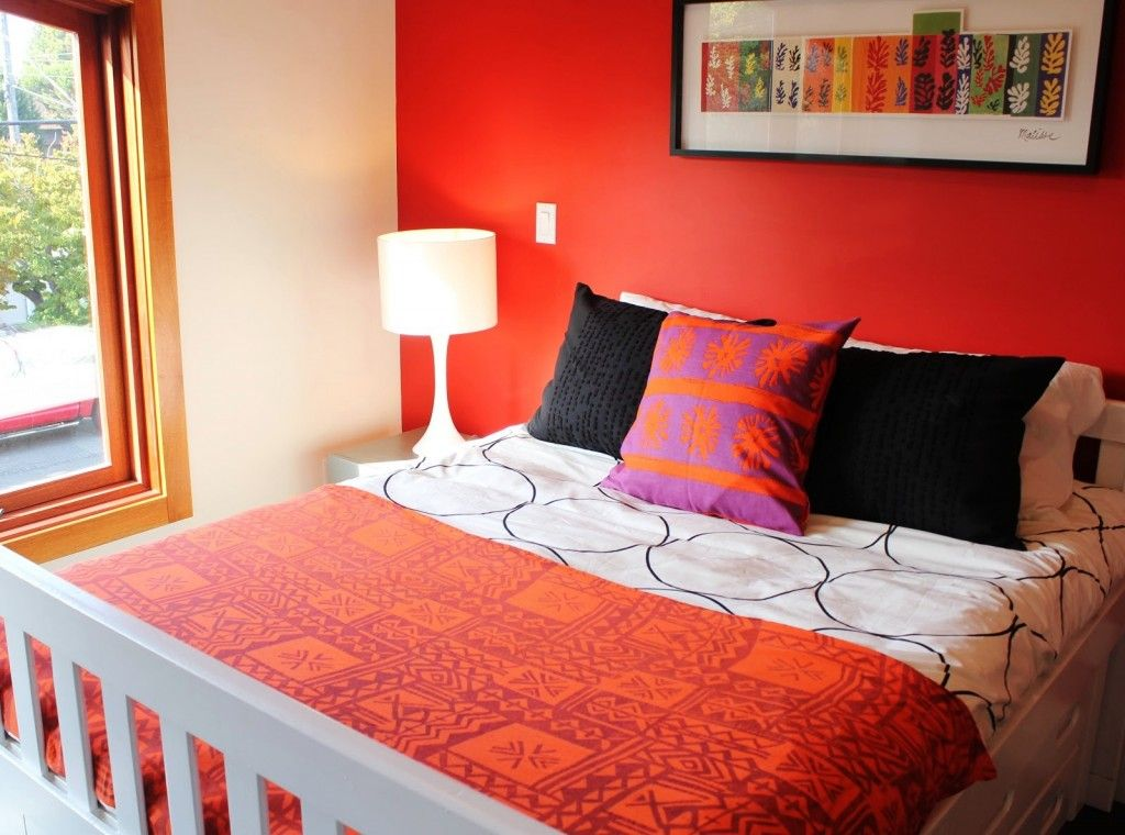 Interesting Red And White Combination Bedroom Wall Colors With Bed Black Cover Pillow Also