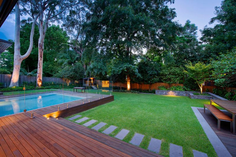 pool and decking  lawn with edge garden beds  stone pavers  the complete package