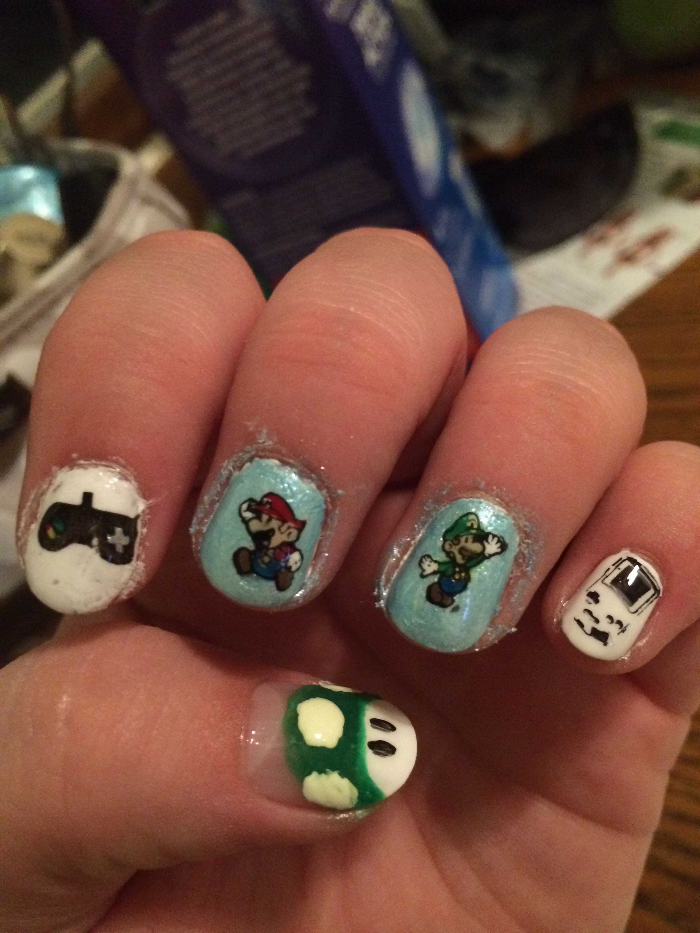 Super Mario nail art! Done using a Konad stamper and scraper kit ...